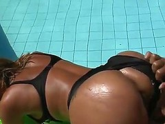 Suzy Anderson exposes delights previous to Tony Tigrao mendacious near swimming pool. This guy massages her great body at hand oil, licks loving holes of hotty and begins screwing her hard.