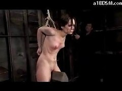 Slender Cutie With Fastened Arms Tortured With Movies Whipped In The Dungeon
