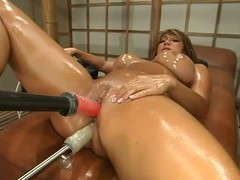 Oiled up swarthy Ava Devine jumps on a fucking machine