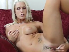 A-Sweet-blonde have a hunch fucking her own juicy vagina on couch