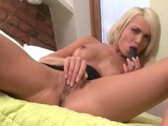 Leggy blond in high heels masturbates solo