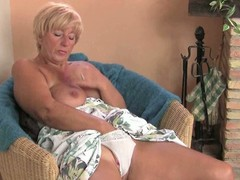 Large granny pleasures her cum-hole with a dildo