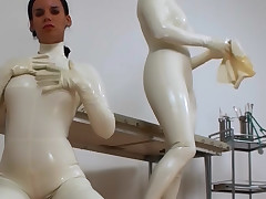 White latex chick gets twat eaten trough someone's skin slit